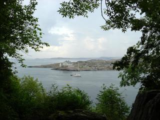 an island, a lighthouse, a yacht