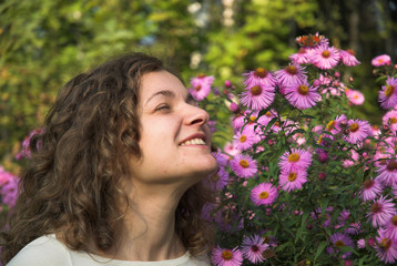 girl is smelling flowers