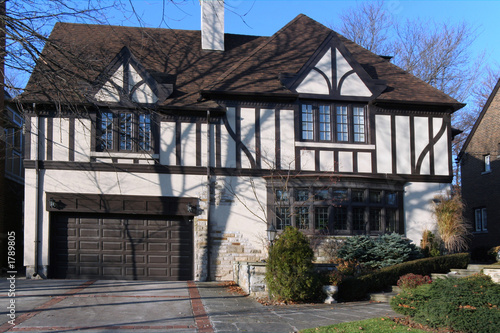 Tudor style house with two car garage stock photo and royalty free tudor style house with two car garage reheart Images