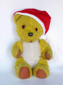 vintage teddy bear in a christmas hat