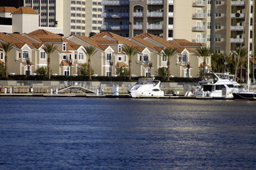 homes and boats on river