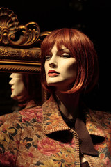 mannequin with a mirror