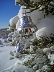 christmas bells and a snowy tree