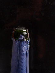 neck of a bottle of champagne on a black background