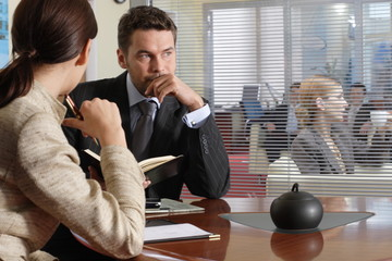 interview thinking business man & woman in office