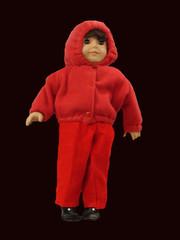 lifelike doll in snowsuit