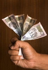 man holding indian currency