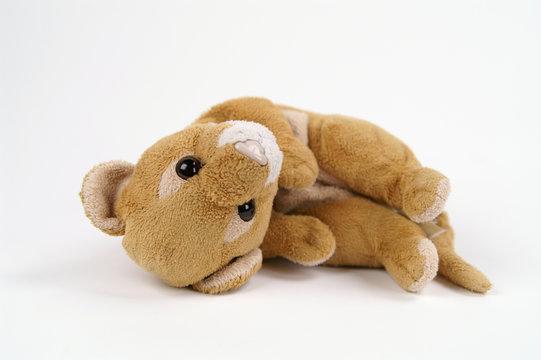 laying plush lion