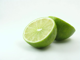 green lime on white cut in half