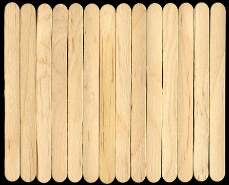 a line of wooden lollipop sticks, isolated on a bl
