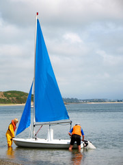 small sailing boat and crew