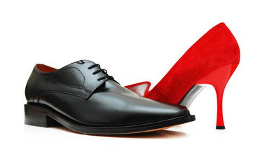 black male shoe and red female shoe isolated on wh
