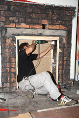 electrician fixing socket boxes