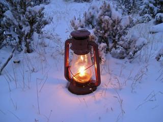 oil lamp in snowy winter evening