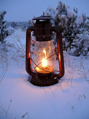 oil lamp in snowy winter evening