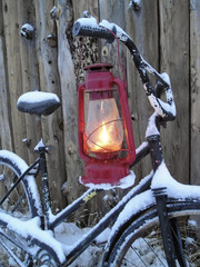 oil lamp and an old bike in winter evening