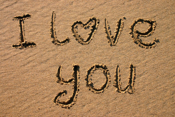 i love you, written on a beach.