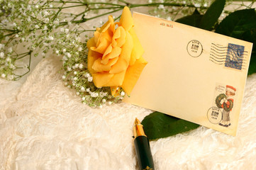 yellow rose and postcard