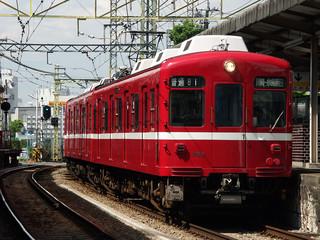 red commuter train kawasaki,japan