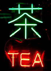 a neon sign of tea in chinese - learn chinese