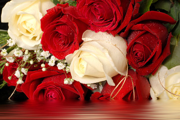 bouquet of red and white roses in water