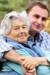 elderly woman with her grandson