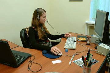 the young girl at office behind a computer