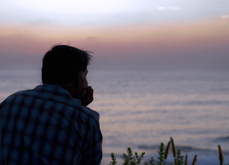 man looking at the pacific ocean