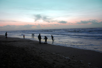 family on the beach in the winter