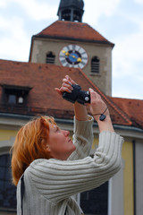 woman take a picture against the tower background