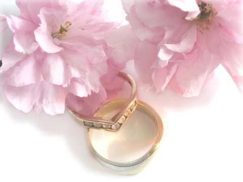wedding rings and cherry blossom flowers