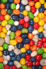 vertical background made of multi-coloured sweets with raisin 1
