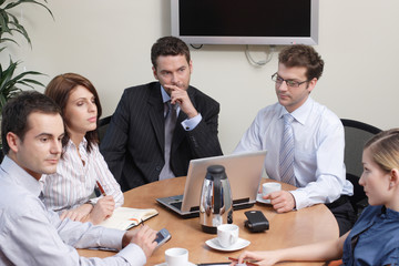 group of 5 business people working  on project