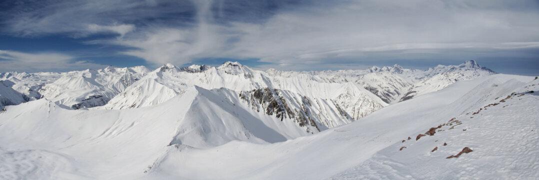 high snow mountains under cloudy sky