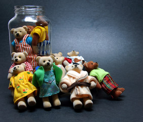 bear family in a jug