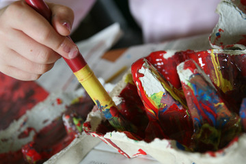 child with paint brush