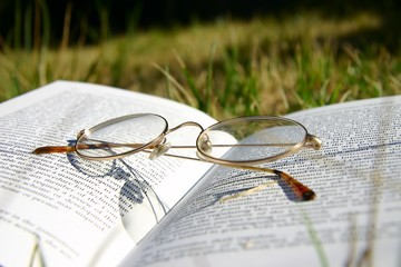 reading glasses on a book outside