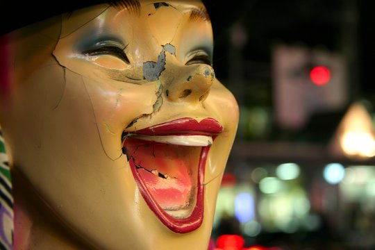 laughing broken mannequin face