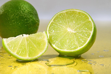limes on yellow surface