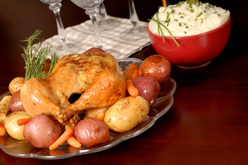 roasted chicken and vegetables with mashed potatoes and rosemary
