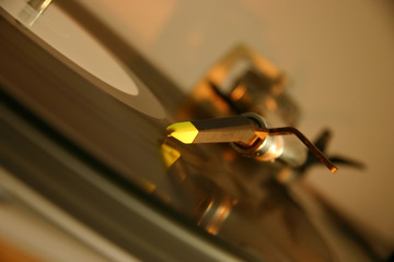 stylus and cartridge on a silver dj turntable