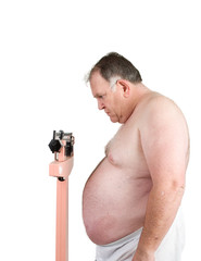Overweight man weighing himself on scale