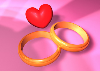 two gold rings with heart symbol