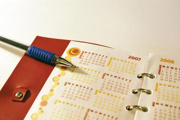 agenda with pen