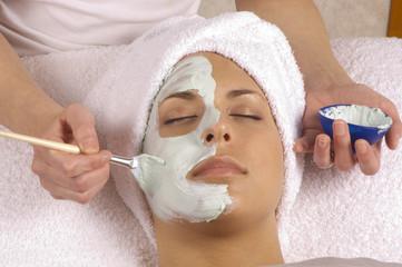 spa esthetician applying organic facial masque