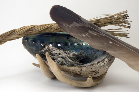 sage,sweetgrass, and eagle feather