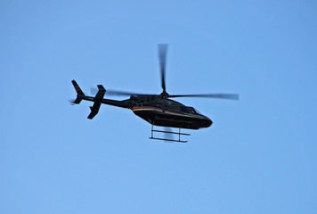 bell 407 helicopter flying overhead