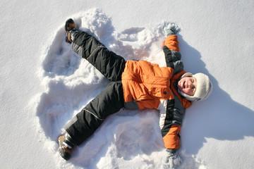 boy lies on north pole snow