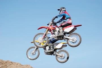 dirt bikes jumping in the air