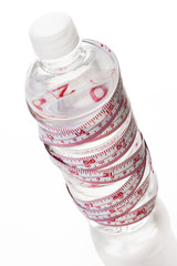 water bottle wrapped with a tape measure